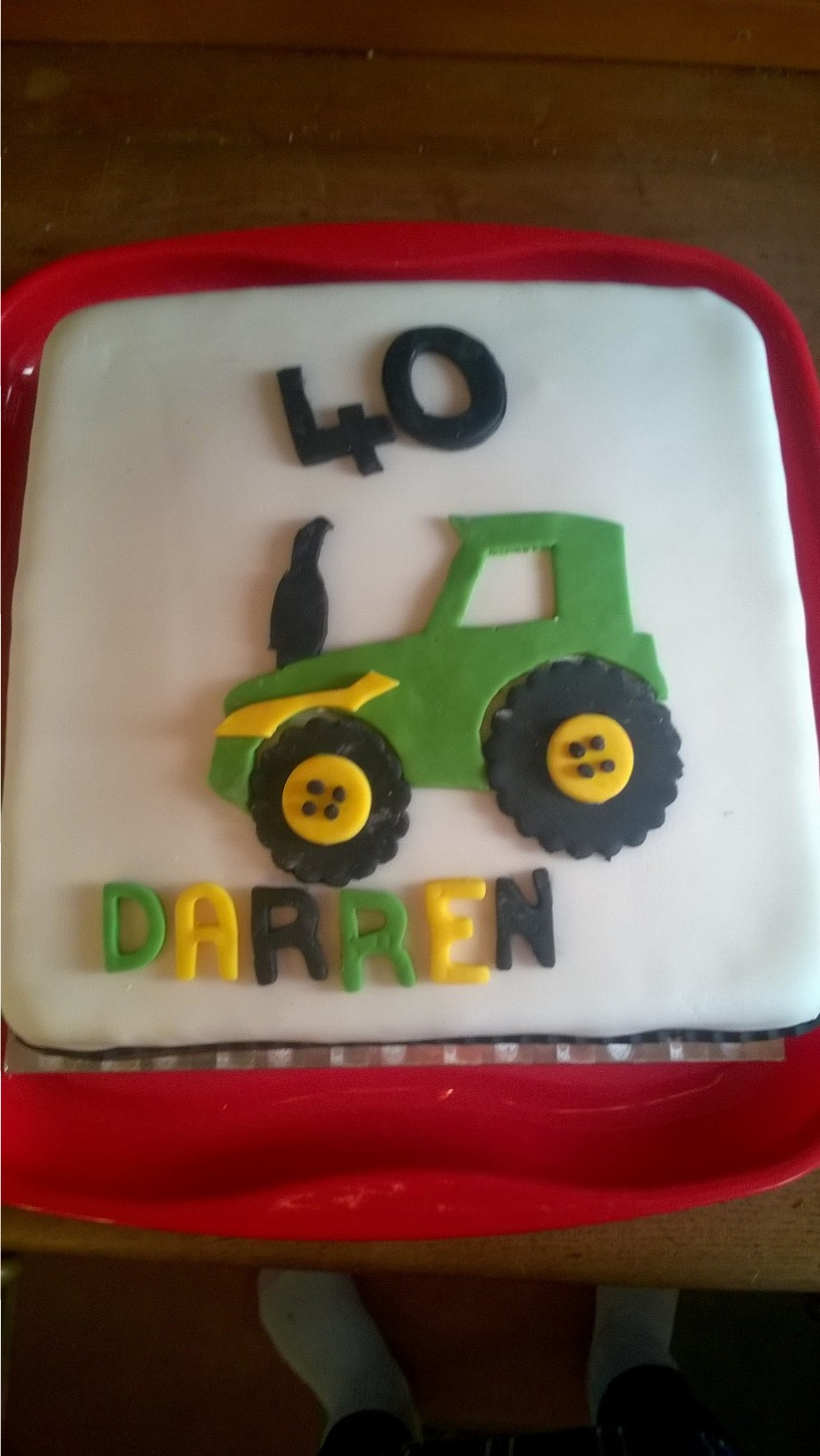 A 40th Birthday Cake Design Featuring Tractor Decoration Made From Icing